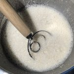 dough whisk mixing starter and water